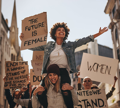 women protesting and holding a