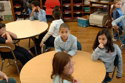 Students sitting at a classroom table