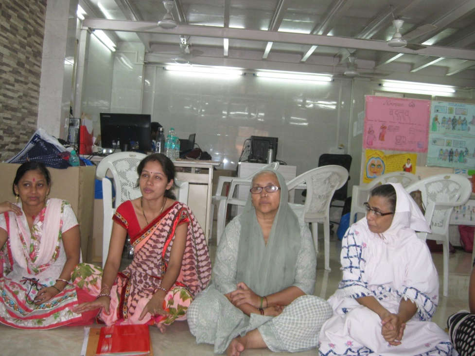 Four women of India Marketplace siting together