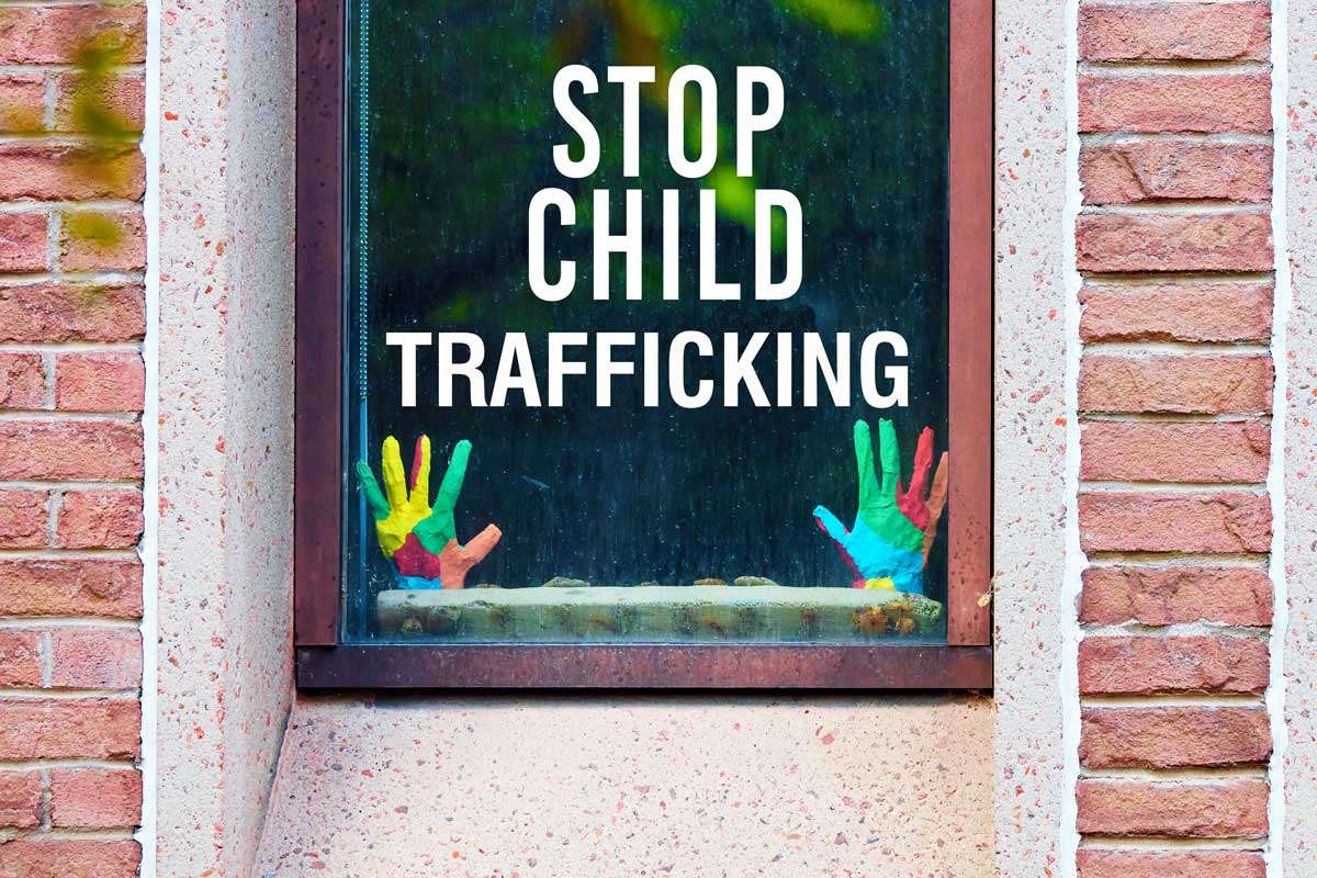 Window that says Stop Child Trafficking