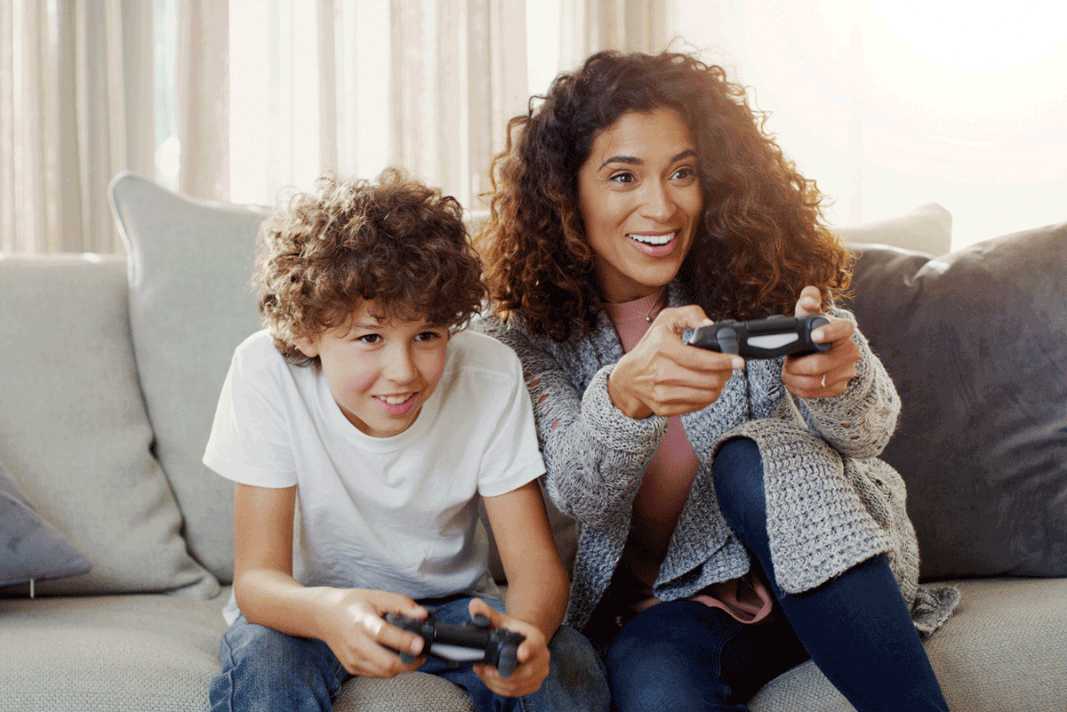 Mother and son play video games