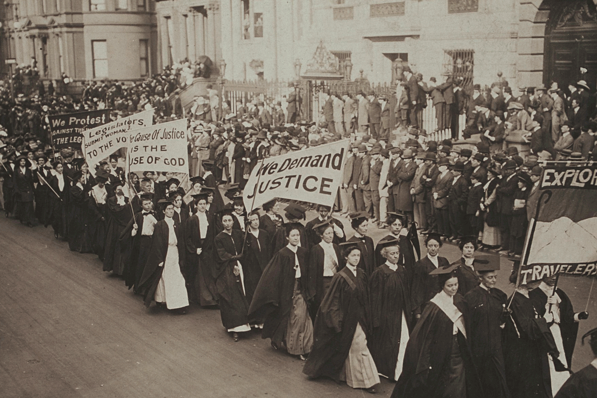 Women in academic dress marching in a suffrage parade in New York City, 1910.