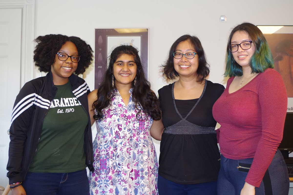 three Wellesley College student research assistants with a Wellesley Centers for Women research scientist
