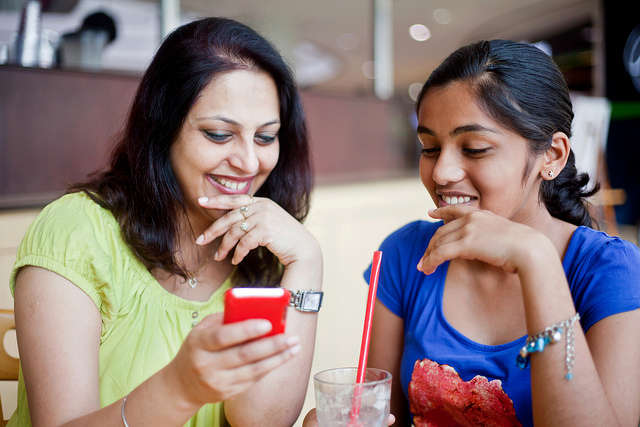 adult woman and young girl in conversation