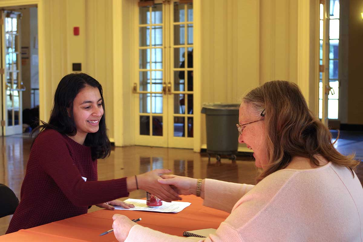 Wellesley College student talks with researcher Wendy Wagner Robeson about a research internship.
