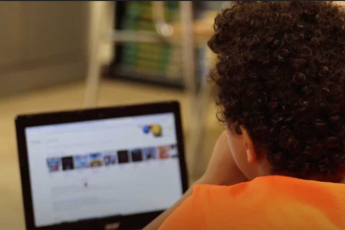 middle school student uses laptop during summer workshop on digital wellbeing