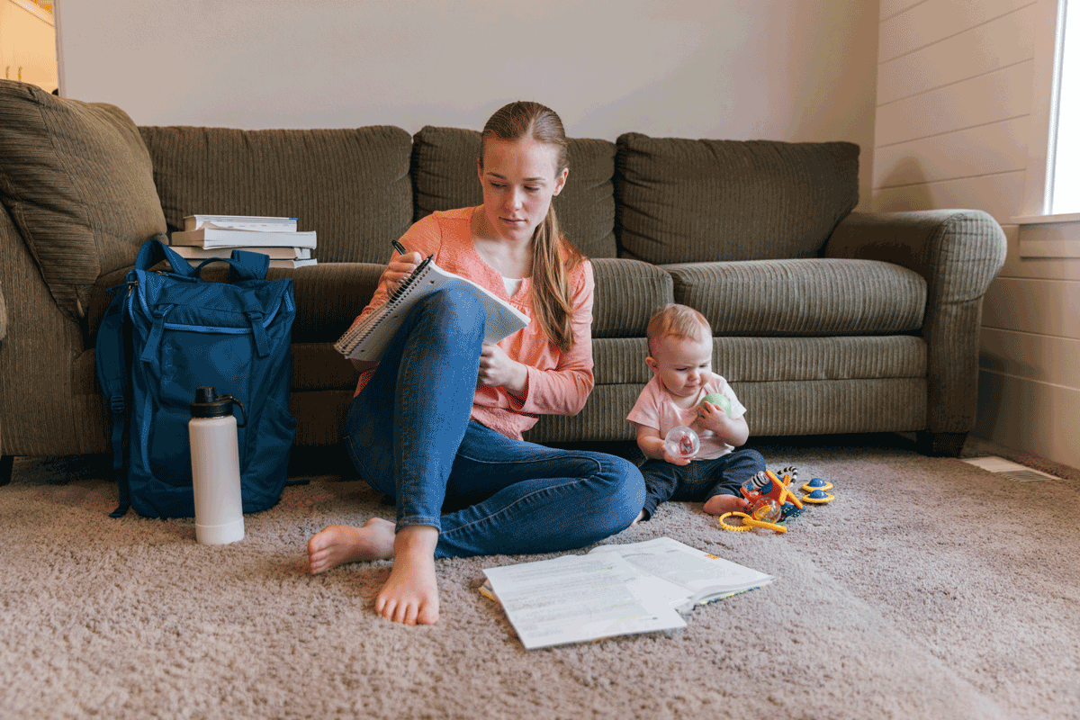 student parent with baby at home