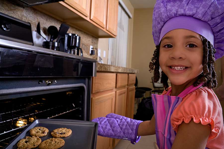 young girl baking cookies