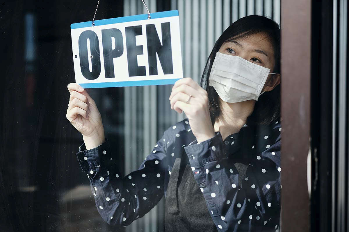 02 woman mask opens store web