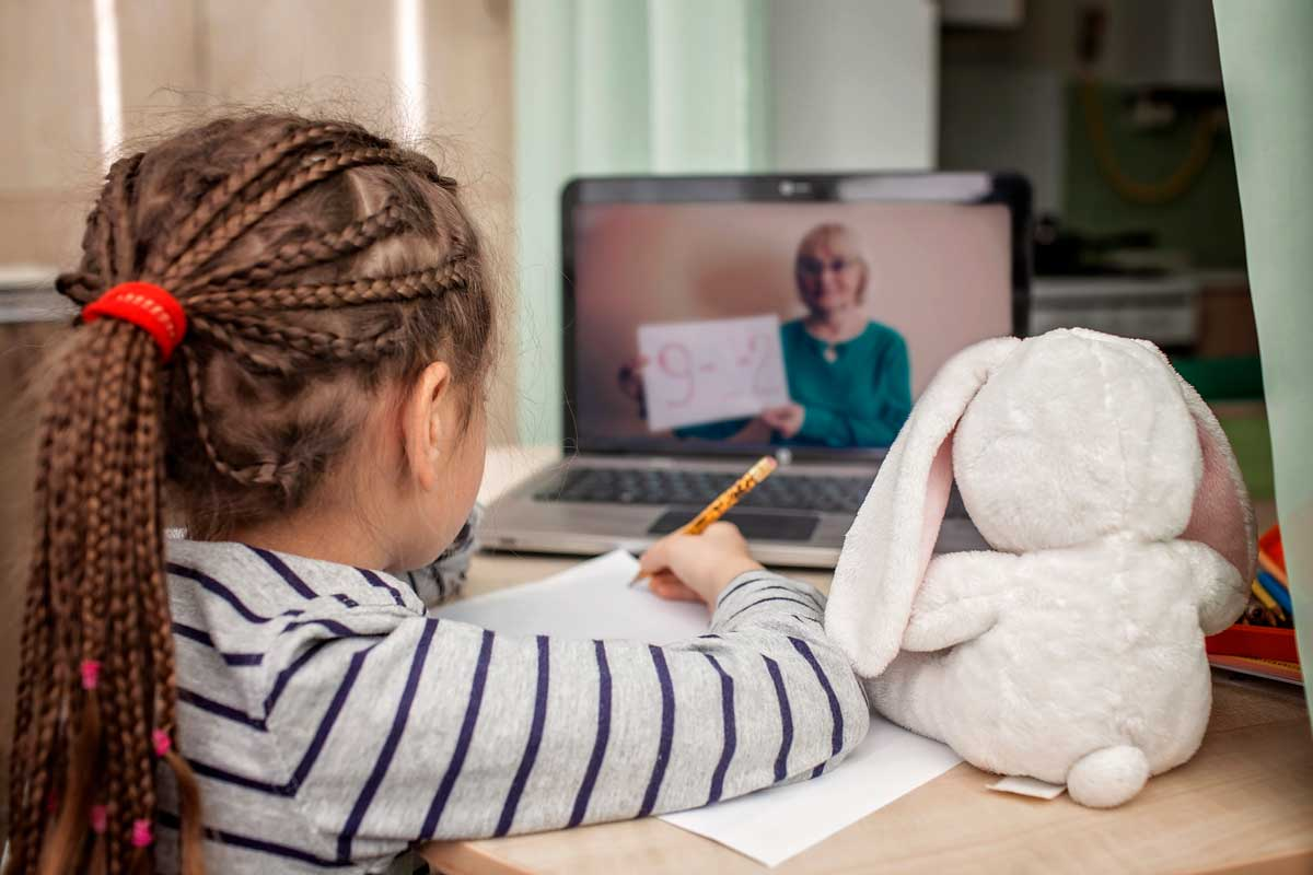 Young girl attends online class